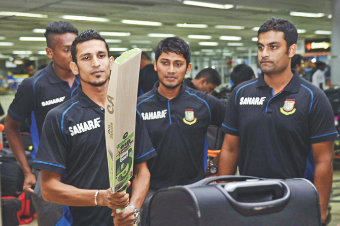 Will this bat bring good times for Nasir? ... Bangladesh cricket team members at the Hazrat Shahjalal International Airport prior to their departure for the West Indies last night. PHOTO: STAR