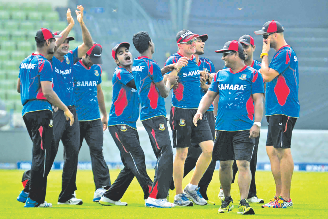 The Bangladesh team seem in high spirits during practice at the Sher-e-Bangla National Stadium in Mirpur yesterday, ahead of today's World Twenty20 Super 10 match against West Indies here.  PHOTO: STAR