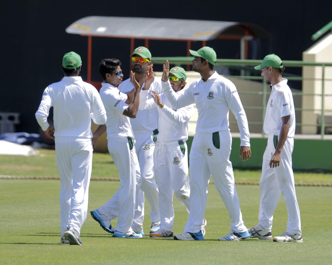 Bangladeshi players celebrate slow left-armer Taijul Islam's first wicket of the West Indies tour during the second day of their three-day practice match against St Kitts and Nevis at St Kitts on Sunday. Taijul is expected to make his debut in the Test series for the Tigers.  Photo: WICB