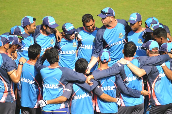 The Bangladesh team, along with coach and support staff, gather in a huddle for a pep talk during practice at the Sher-e-Bangla National Stadium yesterday, ahead of the first Test against Sri Lanka starting here tomorrow.  PHOTO: STAR