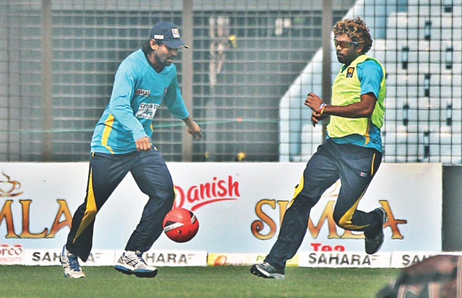 Sri Lanka's short-form specialists Tillakaratne Dilshan and Lasith Malinga, who joined the squad for the limited-overs leg of the tour starting on Wednesday with the first T20I, play a game of football to warm up before practice in Chittagong yesterday. PHOTO: STAR