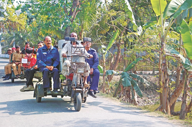 Law enforcers are taking election materials to polling centres in Atghoria upazila of Pabna yesterday, a day before the upazila election Photo: Star