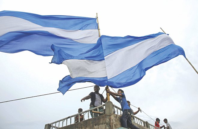 Bangladesh has turned fever pitch ever since the World Cup kicked off in Brazil on June 12. With loyalty divided mostly between two camps, the Argentina section of fans makes sure the flag flies high and handsome before their beloved team's early Monday morning clash against Bosnia and Herzegovina. Photo: Reuters