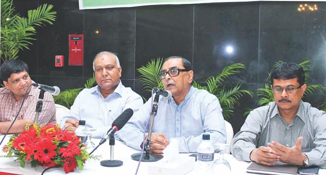 Second from right, Civil Aviation and Tourism Minister Rashed Khan Menon speaks at a workshop on ways to present Bangladesh positively, organised by Bangladesh Tourism Board at Ruposhi Bangla Hotel yesterday. Photo: Banglar Chokh