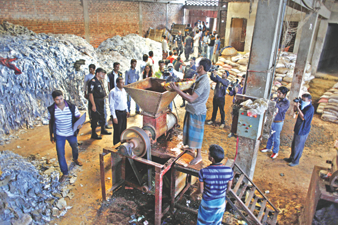 A mobile court backed up by Rab raids a factory in Hazaribagh in the capital yesterday where leather strips, allegedly tainted with chromium, was being used for making poultry feed.  Photo: Rashed Shumon