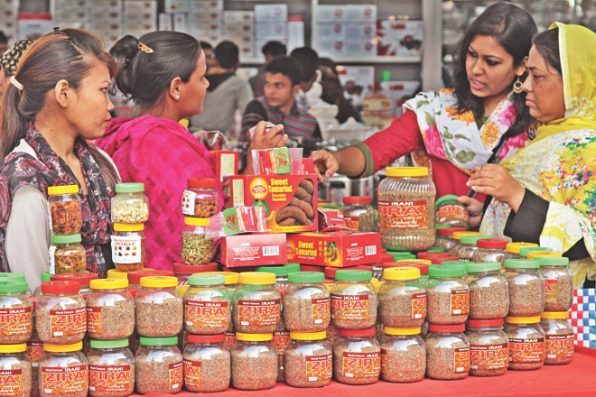 Customers check out spices at a stall at the Dhaka International Trade Fair in the capital. Photo: Star