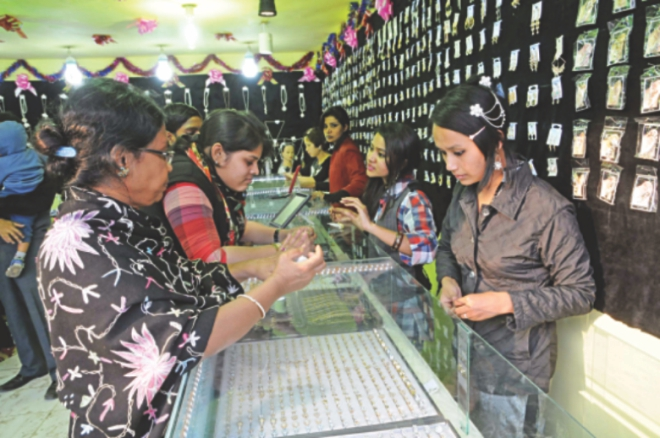 Women check out jewellery at one of the stalls. Photo: Star
