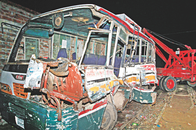 The wreckage of the bus hit by a train at TT Para level crossing in the capital's Kamalapur area last night. The accident occurred as the vehicle was travelling on the wrong side of the road. At least three people were killed and 13 others injured. Photo: Star