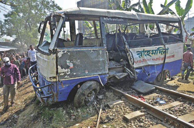 The wreckage of the bus hit by a train at Chandgaon in Chittagong city. The accident left four garment workers dead. Photo: Star