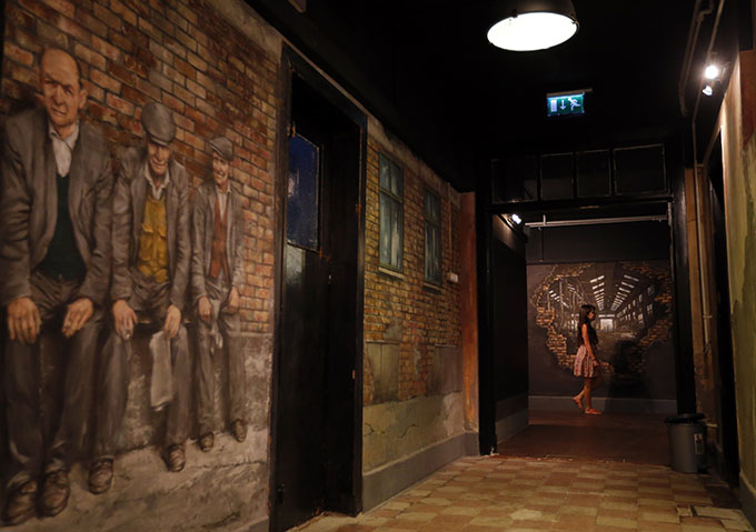 A player walks in the corridor at escape room games TrapFactory in Budapest August 4, 2014. Photo: Reuters