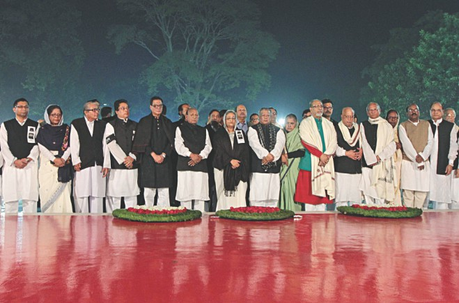 Awami League President Sheikh Hasina and the party leaders pay their respects at the Central Shaheed Minar in the capital in the early hours yesterday marking International Mother Language Day. Photo: Sk Enamul Haq, Anisur Rahman, Palash Khan