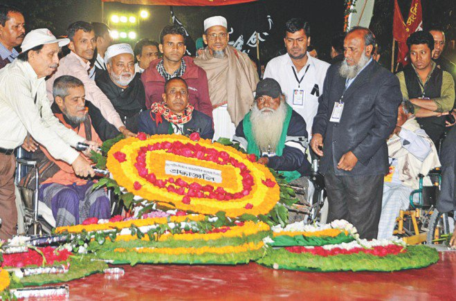 Maimed Liberation War veterans honouring the Language Movement martyrs. Photo: Sk Enamul Haq, Anisur Rahman, Palash Khan