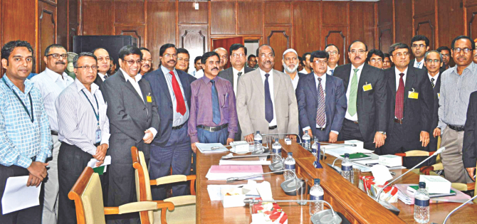SK Sur Chowdhury, deputy governor of Bangladesh Bank, poses with officials of 16 banks after signing deals at BB headquarters yesterday. Photo:BB