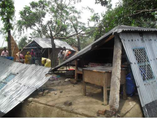 Two houses lie mangled at Baruria village in Chatmohor upazila of Pabna as nor'wester lashed the area on Wednesday night. Photo: Star