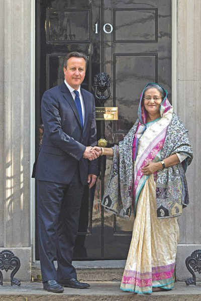 British premier David Cameron greets PM Sheikh Hasina outside 10 Downing Street in London yesterday. Photo: AFP