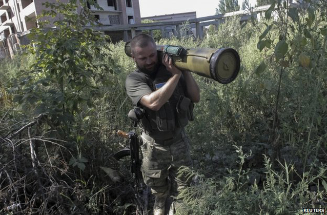 A Ukrainian policeman removes a weapon found in Sloviansk, Donetsk region, on Tuesday. Photo: Reuters