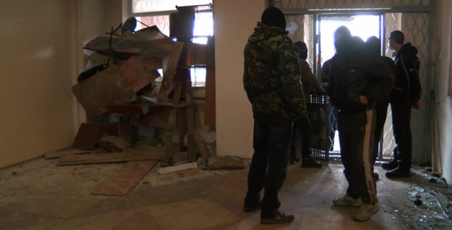 The BBC's Olga Ivshina reports from inside Gorlovka police department near Donetsk, where police and pro-Russian activists are 'cohabiting'. Photo: BBC