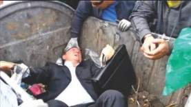 Protesters throw Ukraine MP in trash