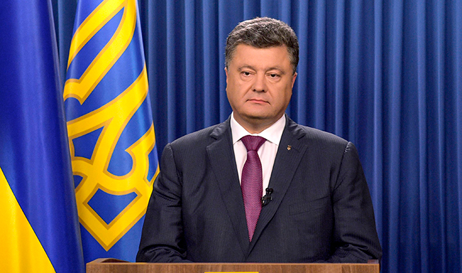Ukrainian President Petro Poroshenko delivers a speech dedicated to his decree to dissolve parliament in Kiev, August 25. Photo: Reuters