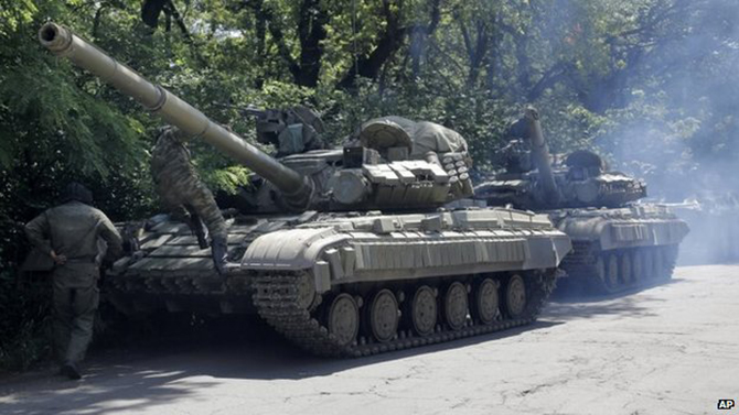 Ukraine fighting rages despite truce