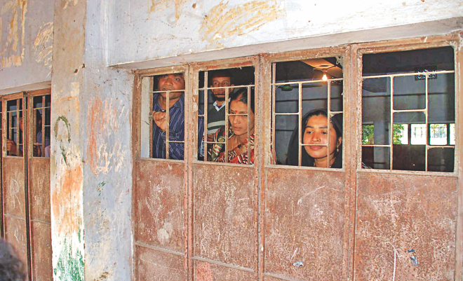 Election officials at the Mithanala Ram Dayal High School polling centre in Mirersarai of Chittagong lock themselves inside the polling booth after supporters of a chairman candidate backed by the ruling party attacked the polling centre yesterday. Photo: Courtesy