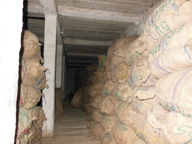 Huge quantity of potatoes lie stacked at Kishan Cold Storage in Rangpur city as the traders did not withdraw them by the stipulated time last December due to drastic price fall of the popular winter vegetable because of  blockades and hartals during the last couple of months. PHOTO: STAR