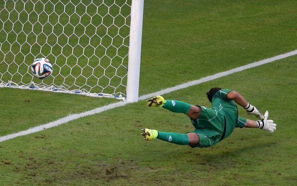 Costa Rica's goalkeeper Keylor Navas fails to save a goal by Uruguay's forward Edinson Cavani (not seen) during a Group D football match between Uruguay and Costa Rica at the Castelao Stadium in Fortaleza during the 2014 FIFA World Cup on June 14, 2014. Photo: AFP/Getty Images