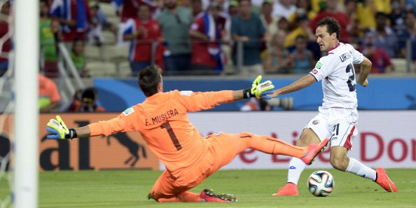 Costa Rica's forward Marco Urena (R) scores his team's third goal against Uruguay's goalkeeper Fernando Muslera during a Group D football match between Uruguay and Costa Rica at the Castelao Stadium in Fortaleza during the 2014 FIFA World Cup on June 14, 2014. Photo: AFP/Getty Images