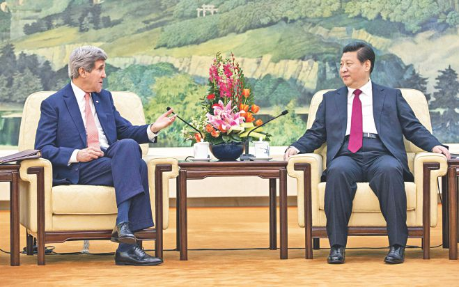 US Secretary of State John Kerry, left, listens to Chinese President Xi Jinping at the Great Hall of the People in Beijing, yesterday. Kerry met with Xi amid increasingly tense territorial rows between Beijing and Washington's security allies Tokyo and Manila. Photo: AFP