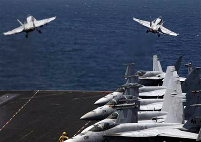US F/A-18 fighter jets take off for mission in Iraq from the flight deck of the US Navy aircraft carrier USS George HW Bush, in the Persian Gulf, August 11. Photo: AP