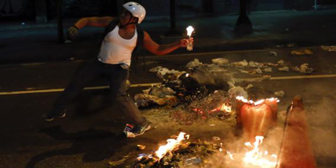 A demonstrator throws a molotov cocktail during a protest against Venezuela's President Nicolas Maduro's government in Caracas February 12. Photo: Reuters