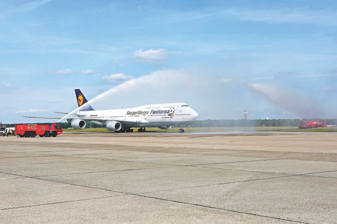 Earlier the aircraft named Victor Plane that carried the players home from Rio de Janeiro was given a water salute on its arrival at the Tegel Airport in the German capital.  PHOTOS: REUTERS