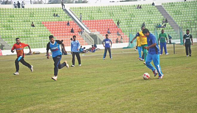 Scheduling of the Victory Day T20 Cup gave the cricketers a rest day yesterday, yet some players of Mohammedan and UCB BCB XI availed the opportunity to enjoy a game of football at the Sylhet Divisional Stadium. PHOTO: STAR