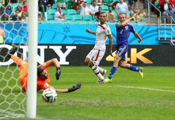 Avdija Vrsajevic of Bosnia and Herzegovina shoots and scores his team's third goal past goalkeeper Alireza Haghighi of Iran during the 2014 FIFA World Cup Brazil Group F match between Bosnia and Herzegovina and Iran at Arena Fonte Nova on June 25, 2014 in Salvador, Brazil. Photo: Getty Images