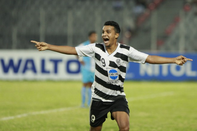 Mohammedan striker Wahed Ahmed celebrates his decisive goal against Abahani in the Bangladesh Premier League match at the Bangabandhu National Stadium yesterday. PHOTO: STAR