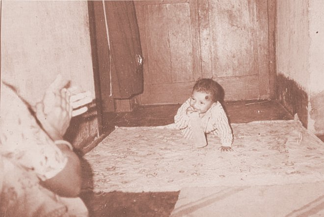 This old photo from the family album shows mother Laily clapping so that her infant son Rajib smiles for the camera. A year and a half later, Rajib died after he was given toxic paracetamol syrup. Photo: Courtesy of Laily Begum