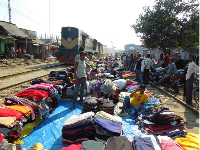 Ignoring the risk of fatal accident anytime, dozens of second hand warm clothes sellers have set up makeshift shops just beside the rail lines at Saidpur station in Nilphamari district, although there is ban on setting up any sales centre within 20 metres from the tracks. PHOTO: STAR