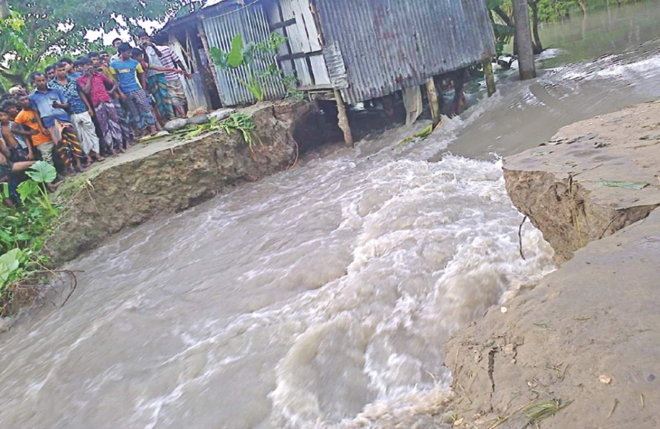 Water enters the villages in Sadar upazila through the breached portion of Bhola town protection dyke. Photo: Star