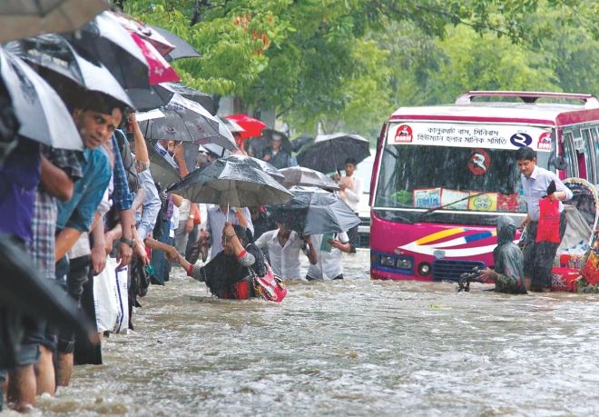 A downpour between the break of dawn and the afternoon yesterday inundated a third of Chittagong city. Vehicles got stuck in the waterlogged streets and people were wading through waist-deep water to get to places. The water eventually subsided. The photos were taken near Gate-2 of the port city. Photo: Anurup Kanti Das