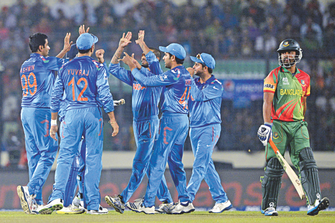 BEGINNING OF THE ROT: India players celebrate the fall of the first Bangladesh wicket as opener Tamim Iqbal (R) trudges back to the dressing room during their ICC World Twenty20 clash at the Sher-e-Bangla National Stadium in Mirpur last night. PHOTO: AFP