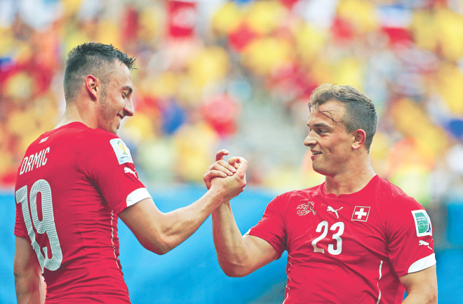 Switzerland's Xherden Shaqiri (R) celebrates one goal of his hattrick against Honduras with Josip Drmic during their World Cup Group E match at Arena Amazonia in Manaus on Wednesday. Photo: Reuters
