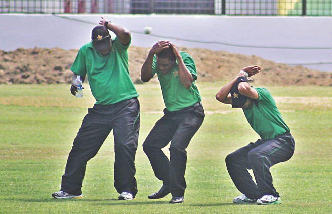 WATCH OUT! Three Zimbabwe players duck to avoid being hit by a ball at the MA Aziz Stadium in Chittagong yesterday. Photo: Anurup Kanti Das