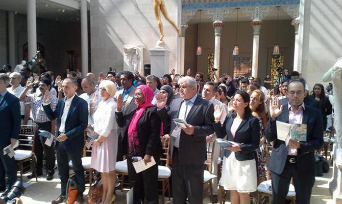 Oath taking ceremony for being US citizen. Photo taken from US Citizenship and Immigration Service's facebook page