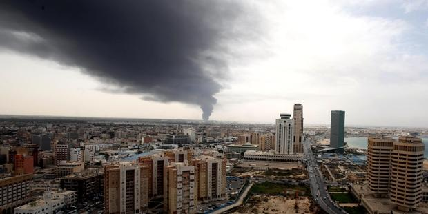 Smoke fills the sky over Tripoli after rockets are fired by one of Libya's militias. Photo taken from Amnesty international