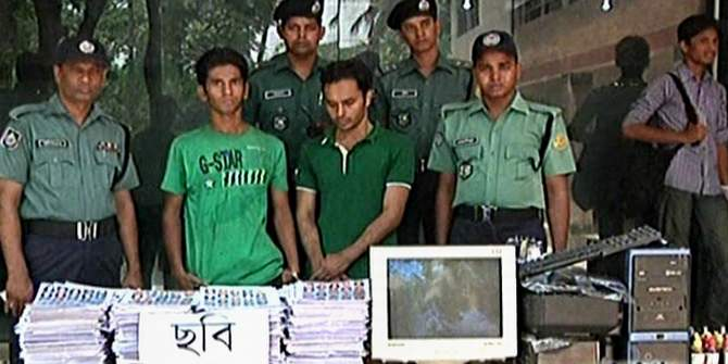 Law enforcers produce two men with fake national identity (NID) cards before the reporters at Dhaka Metropolitan Police media centre in Minto Road of the capital on Saturday. Photo: TV grab
