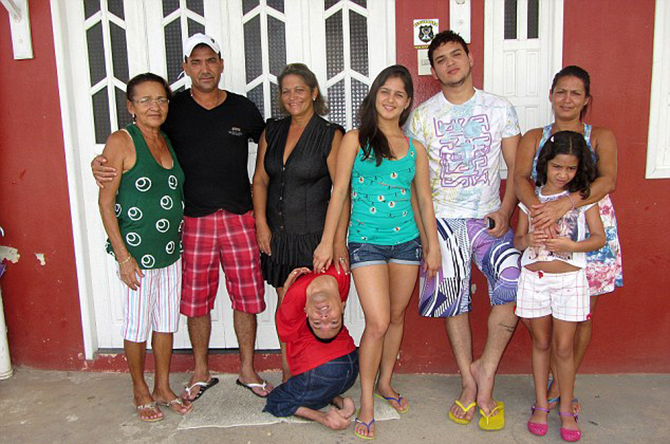 Survivor: Doctors told his mother, Maria Jose Vieira Martins (far left), to stop feeding him as a newborn as they believed he had no chance of survival (pictured with her and members of his family). Photo taken from Barcroft media