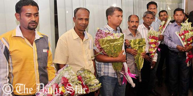 Seven Bangladeshi sailors get floral reception on their arrival at Hazrat Shahjalal International Airport in the capital Thursday morning. They were captive by Somali pirates for over three years and freed last week. Photo: Palash Khan