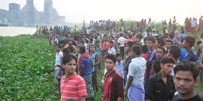 This Star photo shows locals gather on the back of the Shitalakkhya river to see recovery of the bodies of Narayanganj City Corporation panel mayor Nazrul Islam and six others from there on Wednesday and Thursday.