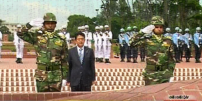Japanese PM pays tributes to the martyrs of 1971 Liberation War by placing wreaths at the National Mausoleum in Savar on Saturday. Photo: TV grab