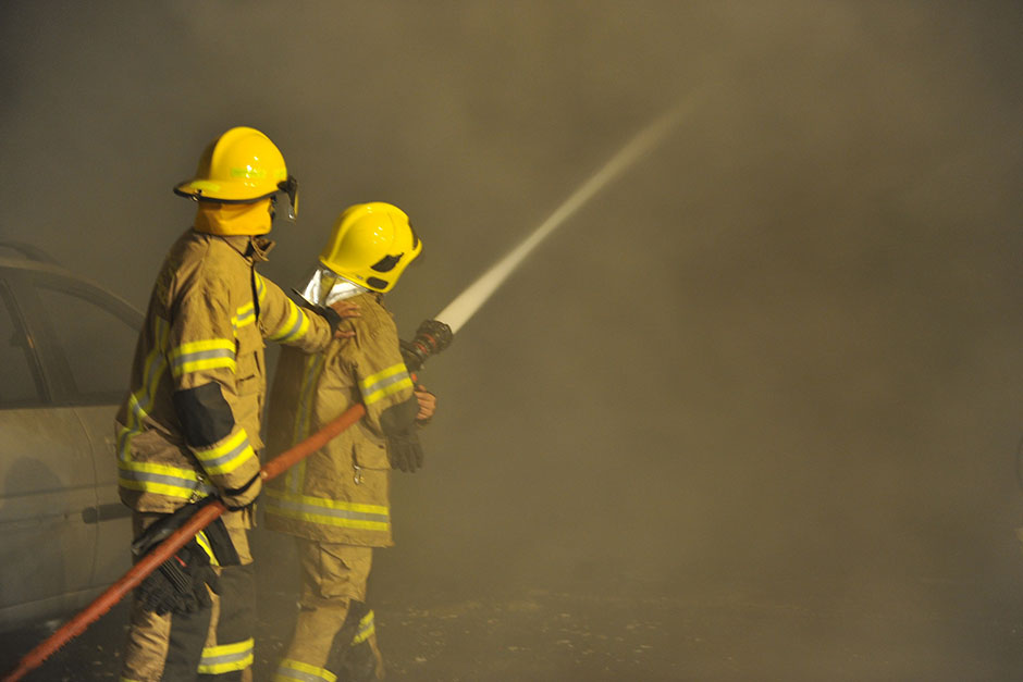 Firefighters try to put out the fire. Photo taken from Gulf News